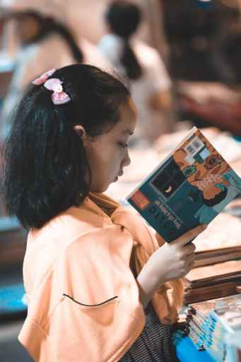 girl holding a story book