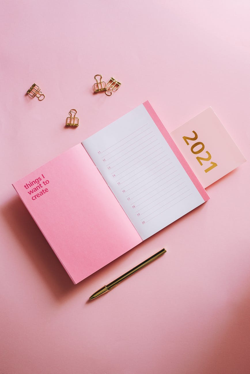woman notebook writing calendar